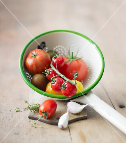 Tomatoes in a draining spoon