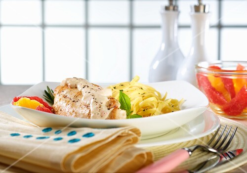 Chicken breast with a creamy sauce, ribbon pasta and citrus fruit