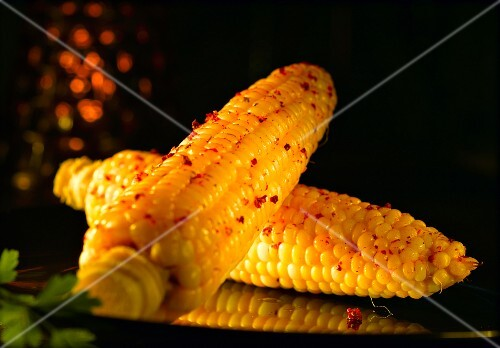 Corn on the cob with red peppercorns