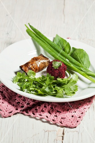 Aubergine rolls and beetroot balls, garnished with herbs (Georgia)