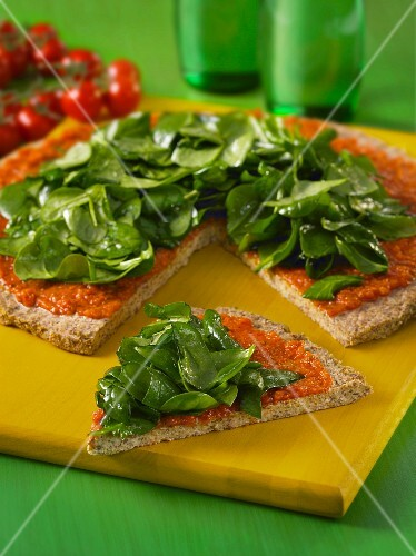 Buckwheat pizza with sunflower seeds, tomatoes and spinach