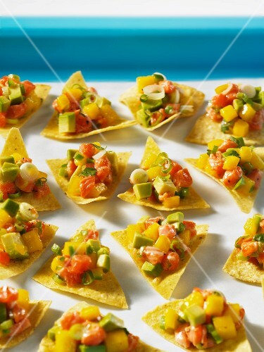 Tortilla chips with mango and salmon ceviche