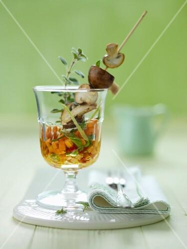A mushroom skewer in vegetable salad