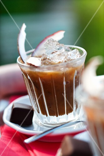 Cold coconut coffee with ice cubes