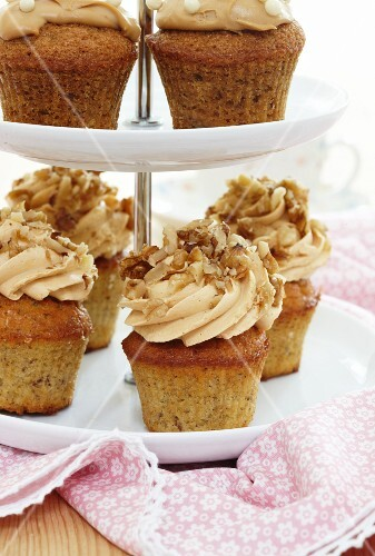 Hazelnut cupcakes on a tiered cake stand