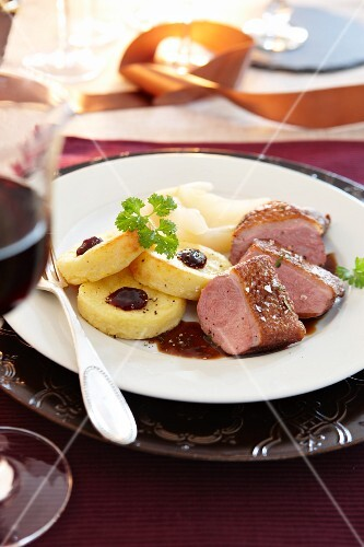 Duck breast with fried potato dumplings and cranberry sauce