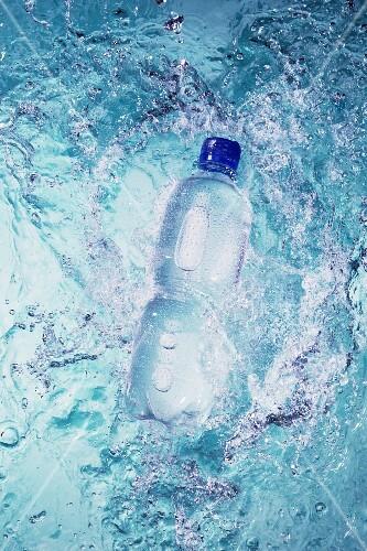 A bottle falling into water