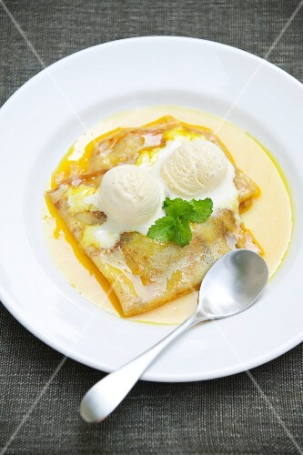 Crepes Suzette with vanilla ice cream