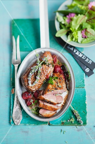 Duck breast with herbs and strawberries