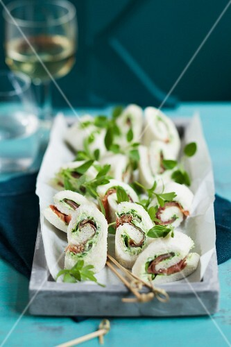 Tramezzini rolls filled with ham and herbs