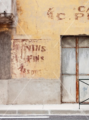 Faded writing on an old house front (Dordogne, France)