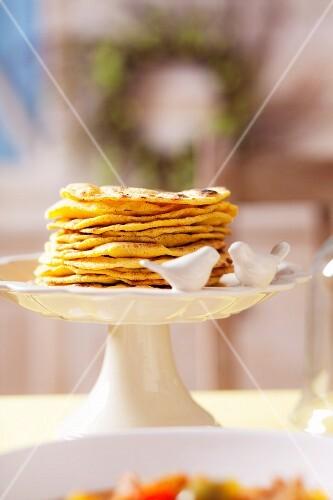 Pita breads on a cake stand