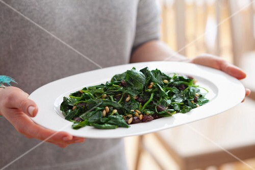 Blanched spinach with raisins and pine nuts