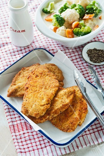 Breaded chicken schnitzels with a side of vegetables