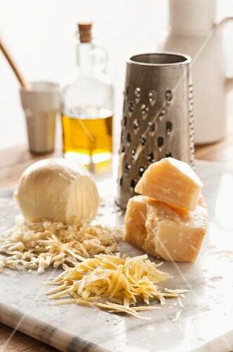 Assorted types of cheese, grated
