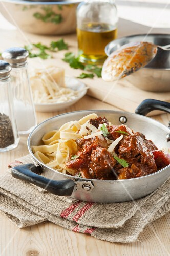Osso buco (stewed cross-cut veal shin) with fettuccine