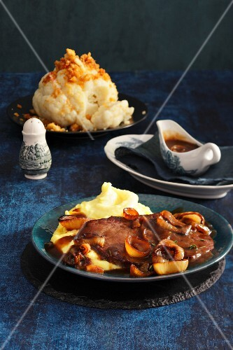 Beef schnitzel with fried onions