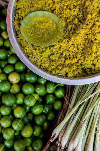 Curry paste, lemon grass and limes at a market in Cambodia