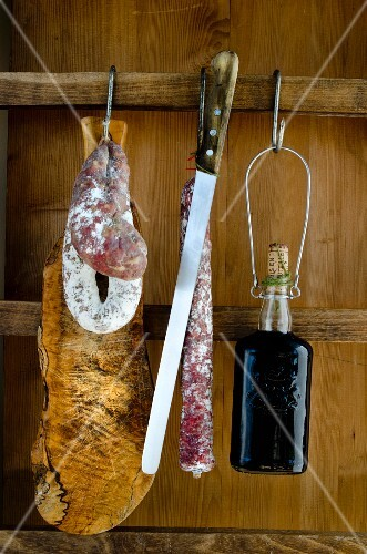 A still life with salami and wine