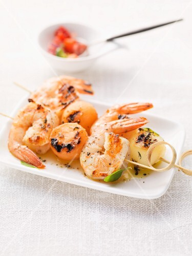 Grilled melon and scampi skewers