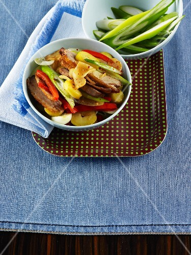 Duck Gröstl (typical Tyrolean dish using leftovers) with potatoes, leeks and peppers