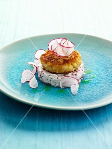 Cauliflower fritter on radish quark