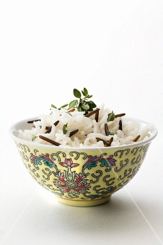 Wild rice in an Asian bowl against a white background