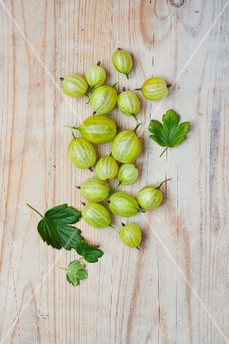 Gooseberries on a wooden surface