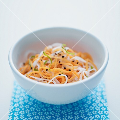 Daikon and carrot salad in a white bowl
