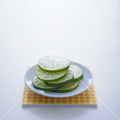 Lime slices on a white plate