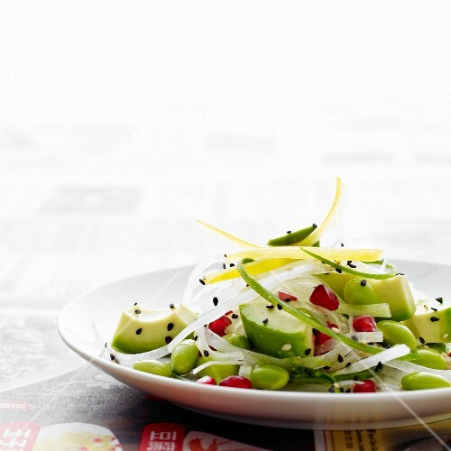Japanese salad of avocado, white radish, soy beans, pomegranate seeds and sesame seeds