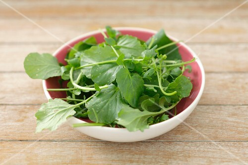 Watercress in a small bowl