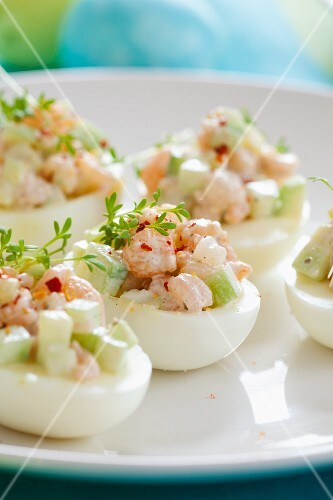 Stuffed eggs with cucumber, prawns and cress