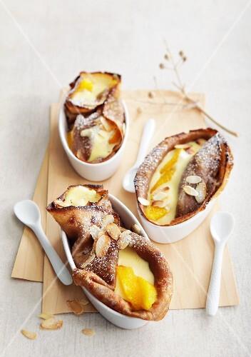 Coffee crepes with orange and mascarpone cream and amaretto