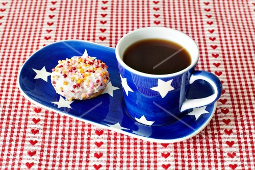 A doughnut and a cup of coffee