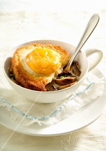 Mushroom soup with toast and egg