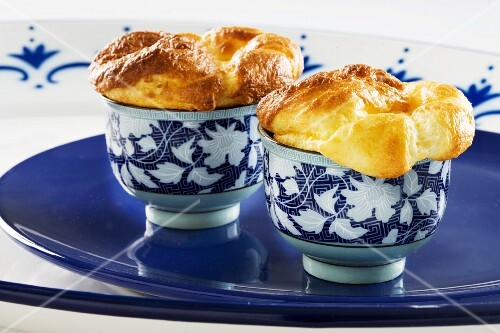 Two cheese soufflés in dishes