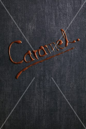 A word written in brown on a grey surface