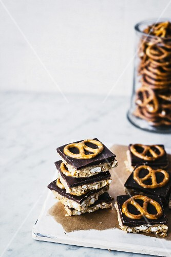 Peanut butter bars with chocolate and pretzels