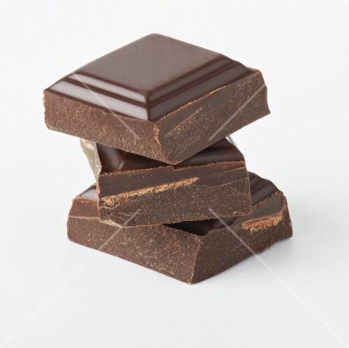 Three chunks of chocolate, stacked