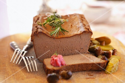 Smooth pâté with pickled vegetables and rosemary