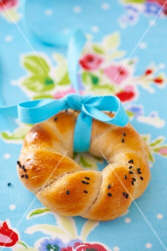 Poppy seeds bagel with tie with ribbon