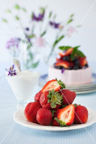 Fresh Strawberries with a Yogurt Cake in the Background