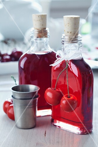 Cherry liqueur in small bottles decorated with fake cherries