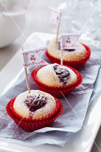 Mini muffins with cherries decorated with ribbon flags