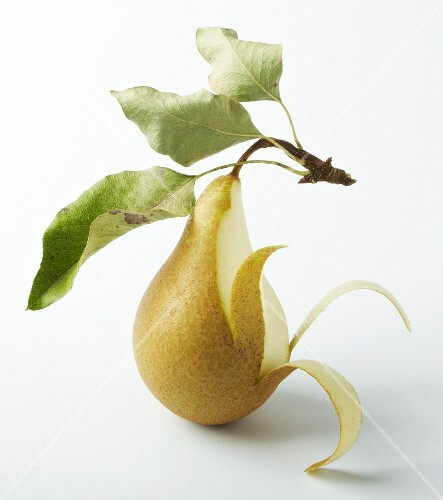 A pear, partly peeled
