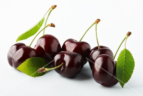 Several cherries with leaves