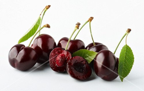 Whole and halved morello cherries