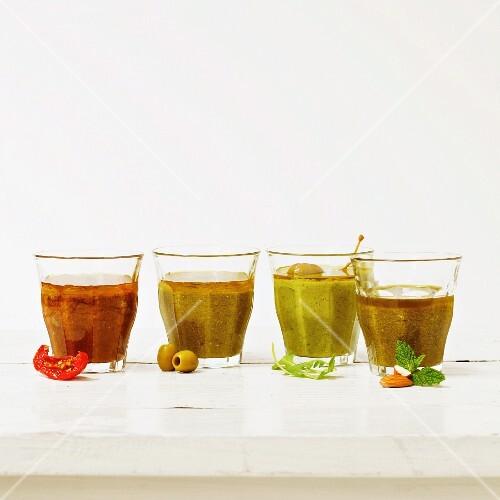 Assorted pesto sauces in glasses