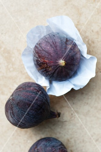 Three figs, one on paper